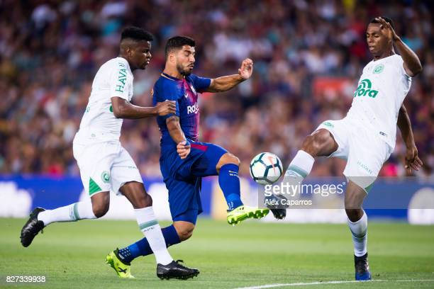 Luis Suarez of FC Barcelona fights for the ball with Moises Ribeiro and Luis Otavio of Chapecoense during the Joan Gamper Trophy match between FC...