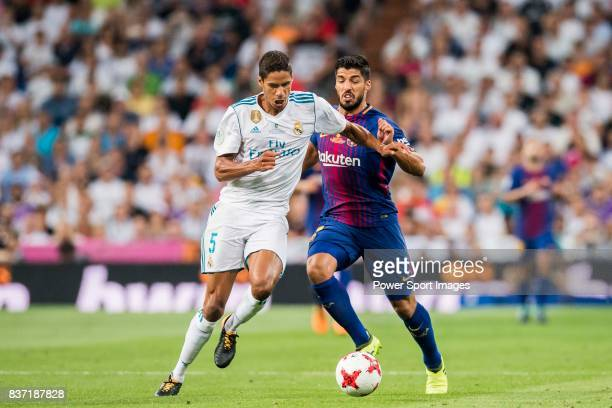 MADRID SPAIN AUGUST 16 Luis Suarez of FC Barcelona fights for the ball with Raphael Varane of Real Madrid during their Supercopa de Espana Final 2nd...