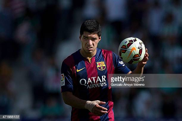Luis Suarez of FC Barcelona holds the ball given by his hack trick after the La Liga match between Cordoba CF and Barcelona FC at El Arcangel stadium...