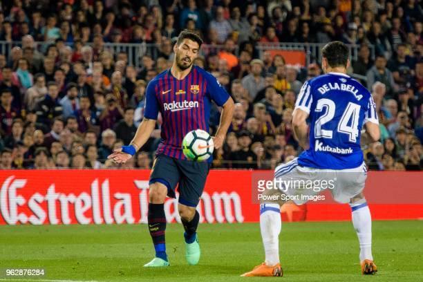 Luis Suarez of FC Barcelona in action against Alberto De La Bella of Real Sociedad during the La Liga match between Barcelona and Real Sociedad at...