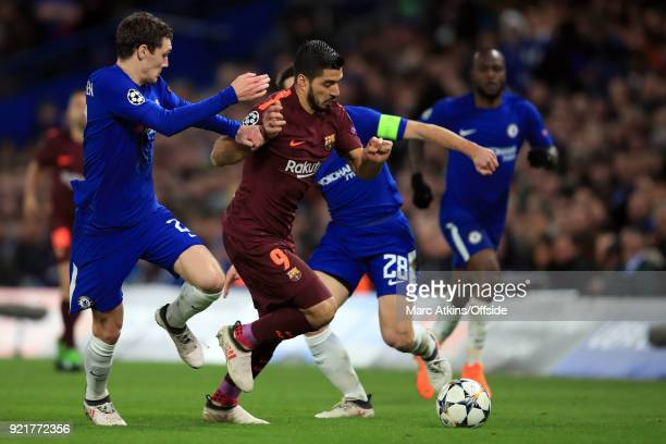 Luis Suarez of FC Barcelona in action with Andreas Christensen and Cesar Azpilicueta of Chelsea during the UEFA Champions League Round of 16 First...