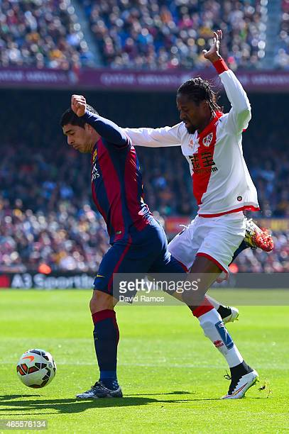 Luis Suarez of FC Barcelona is brought down by Abdoulaye Ba of Rayo Vallecano during the La Liga match between FC Barcelona and Rayo Vallecano de...