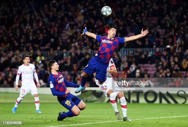 Luis Suarez of FC Barcelona is challenged by Martin Valjent of RCD Mallorca during the Liga match between FC Barcelona and RCD Mallorca at Camp Nou...