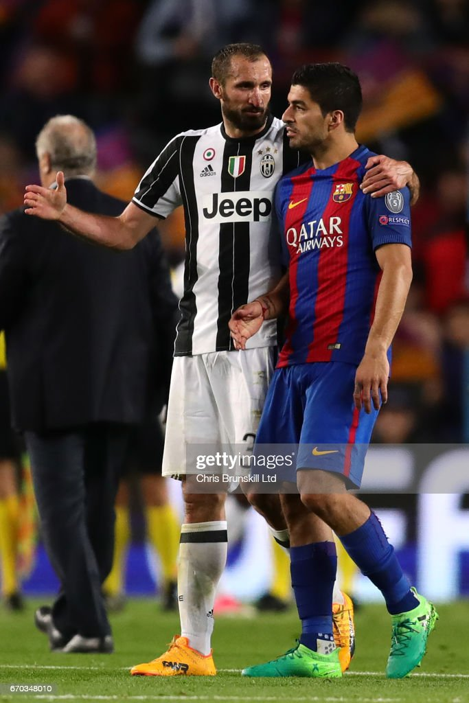 Luis Suarez of FC Barcelona is consoled by Giorgio Chiellini of Juventus at the end of the UEFA Champions League Quarter Final second leg match between FC Barcelona and Juventus at Camp Nou on April 19, 2017 in Barcelona, Spain.