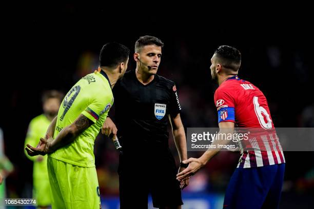 Luis Suarez of FC Barcelona Jesus Gil Manzano referee Koke of Atletico Madrid during the La Liga Santander match between Atletico Madrid v FC...
