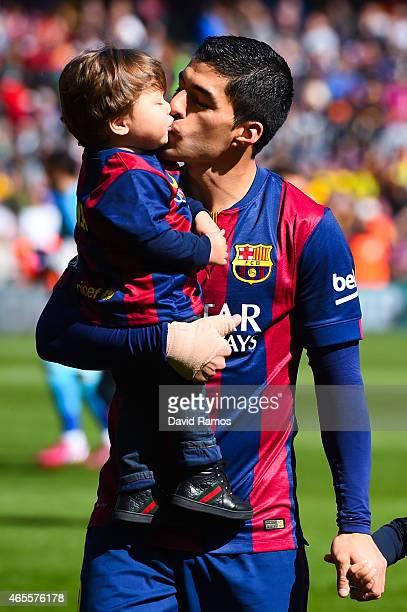 Luis Suarez of FC Barcelona kisses his son Benjamin Suarez prior to the La Liga match between FC Barcelona and Rayo Vallecano de Madrid at Camp Nou...
