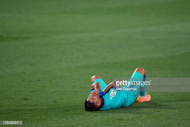 Luis Suarez of FC Barcelona lies on the pitch during the Liga match between Villarreal CF and FC Barcelona at Estadio de la Ceramica on July 05 2020...