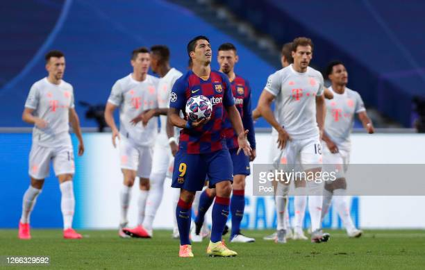 Luis Suarez of FC Barcelona looks dejected after his team concede during the UEFA Champions League Quarter Final match between Barcelona and Bayern...