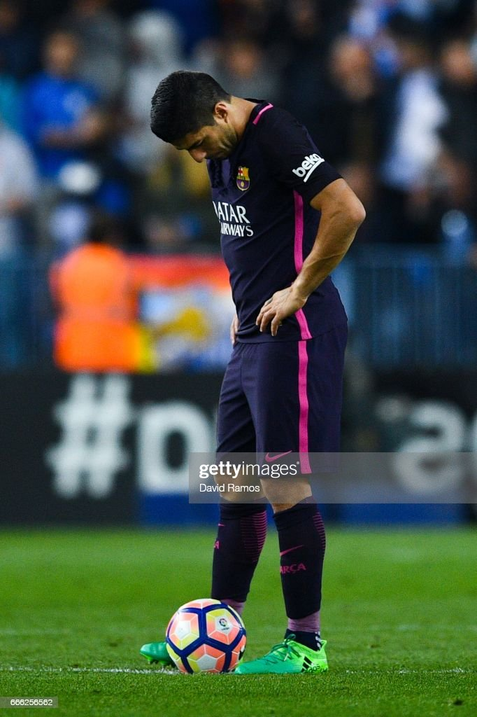 Luis Suarez of FC Barcelona looks on dejected after Jony Rodriguez of Malaga CF scored his team's second goal during the La Liga match between Malaga CF and FC Barcelona at La Rosaleda stadium on April 8, 2017 in Malaga, Spain.