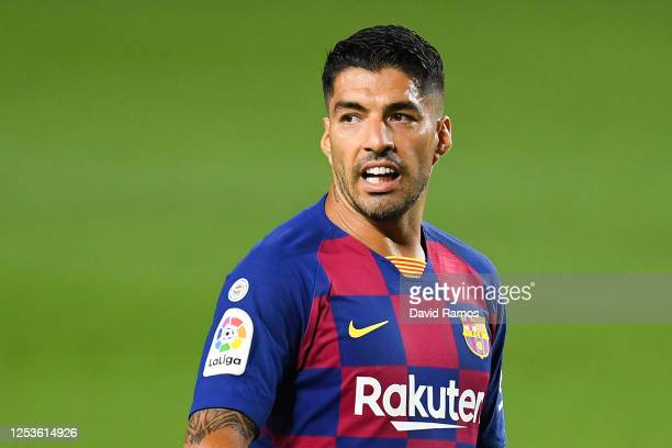 Luis Suarez of FC Barcelona looks on during the Liga match between FC Barcelona and Club Atletico de Madrid at Camp Nou on June 30, 2020 in...