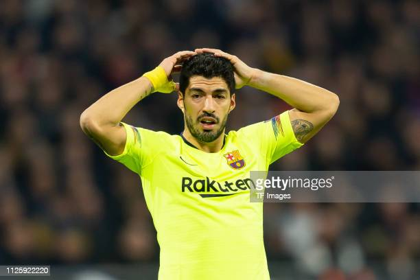 Luis Suarez of FC Barcelona looks on during the UEFA Champions League Round of 16 First Leg match between Olympique Lyonnais and FC Barcelona at...