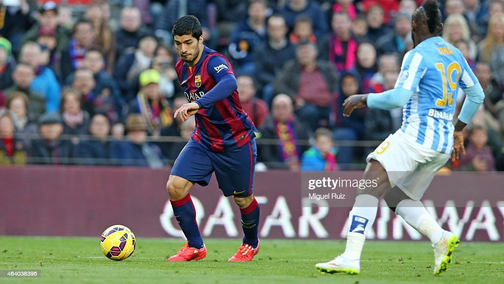 Luis Suarez of FC Barcelona manages the ball during the La Liga match between FC Barcelona and Malaga CF at Camp Nou on February 21, 2015 in Barcelona, Spain.