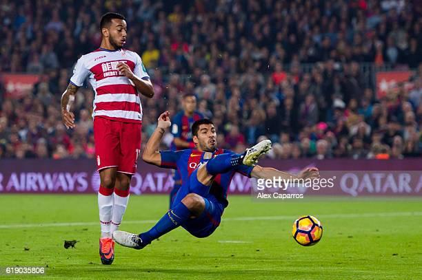 Luis Suarez of FC Barcelona misses a shot next to Ruben Vezo of Granada CF during the La Liga match between FC Barcelona and Granada CF at Camp Nou...