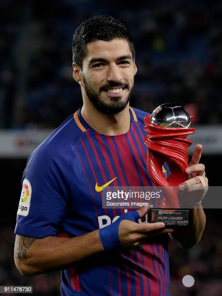 Luis Suarez of FC Barcelona player of the month trophy during the La Liga Santander match between FC Barcelona v Deportivo Alaves at the Camp Nou on...