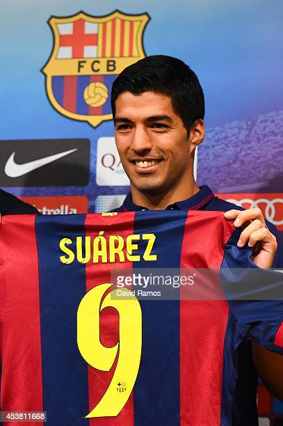 Luis Suarez of FC Barcelona poses for the media during a press conference as part of his presentation as new FC Barcelona player at Camp Nou on...