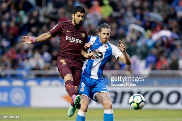 Luis Suarez of FC Barcelona Raul Albentosa of Deportivo La Coruna during the La Liga Santander match between Deportivo la Coruna v FC Barcelona at...