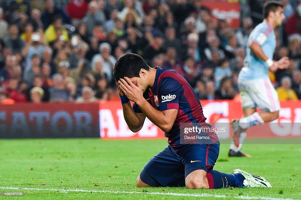 Luis Suarez of FC Barcelona reacts after missing a chance to score during the La Liga match between FC Barcelona and Celta de Vigo at Camp Nou on November 1, 2014 in Barcelona, Spain.