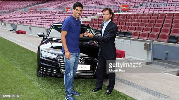 Luis Suarez of FC Barcelona recieves his club car during his presentation as new FC Barcelona player at Camp Nou on August 19 2014 in Barcelona Spain