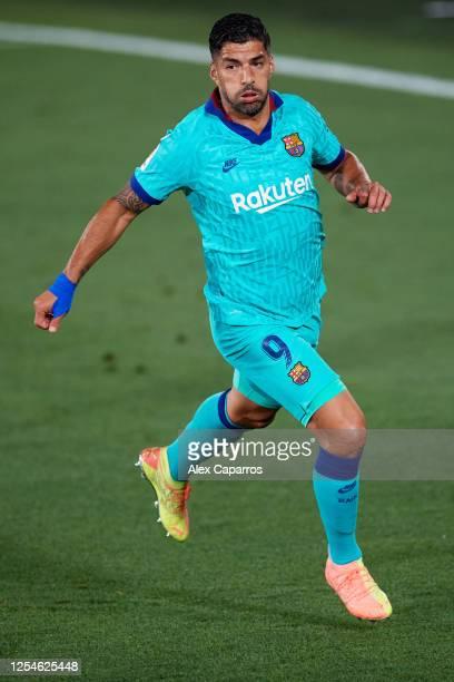 Luis Suarez of FC Barcelona runs during the Liga match between Villarreal CF and FC Barcelona at Estadio de la Ceramica on July 05 2020 in Villareal...