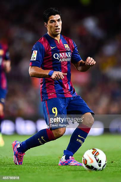 Luis Suarez of FC Barcelona runs with the ball during the Joan Gamper Trophy match between FC Barcelona and Club Leon at Camp Nou on August 18 2014...