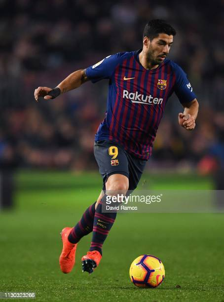 Luis Suarez of FC Barcelona runs with the ball during the La Liga match between FC Barcelona and Real Valladolid CF at Camp Nou on February 16 2019...
