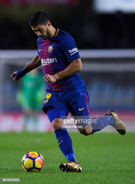 Luis Suarez of FC Barcelona runs with the ball during the La Liga match between Real Sociedad and FC Barcelona at Anoeta stadium on January 14 2018...