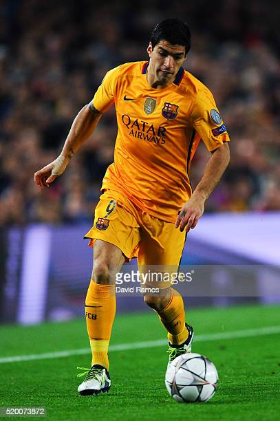 Luis Suarez of FC Barcelona runs with the ball during the UEFA Champions League quarter final first leg match between FC Barcelona and Club Atletico...