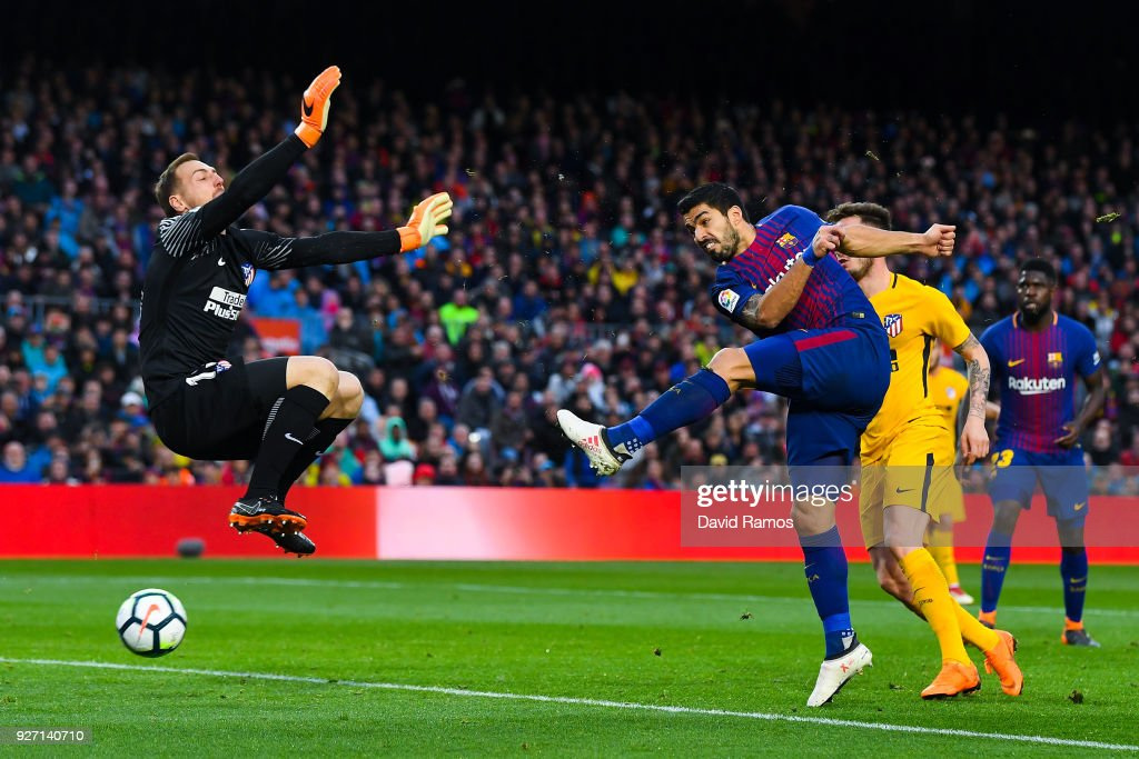 Luis Suarez of FC Barcelona scores a disallowed goal during the La Liga match between Barcelona and Atletico Madrid at Camp Nou on March 4, 2018 in Barcelona, Spain.
