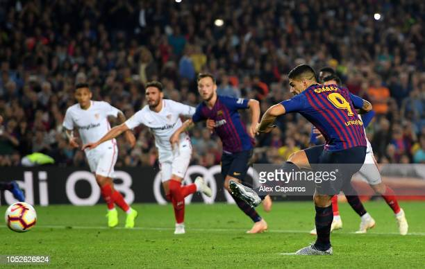 Luis Suarez of FC Barcelona scores his sides third goal from the penalty spot during the La Liga match between FC Barcelona and Sevilla FC at Camp...