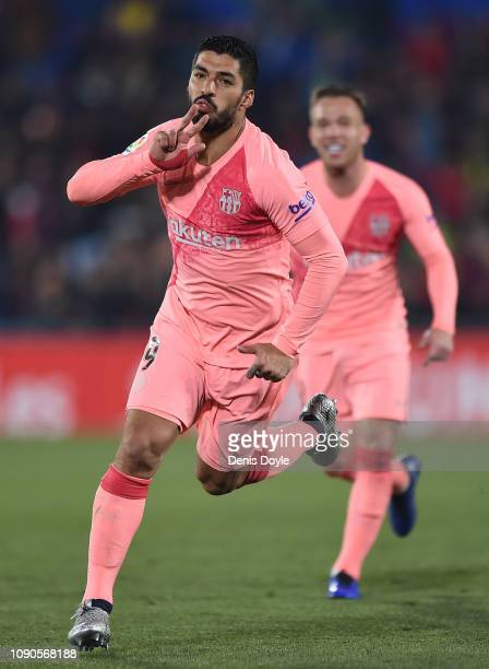 Luis Suarez of FC Barcelona scores his team's 2nd goal during the La Liga match between Getafe CF and FC Barcelona at Coliseum Alfonso Perez on...