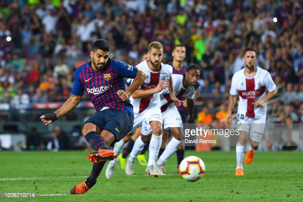 Luis Suarez of FC Barcelona scores his team's eighth goal from the penalty spot during the La Liga match between FC Barcelona and SD Huesca at Camp...