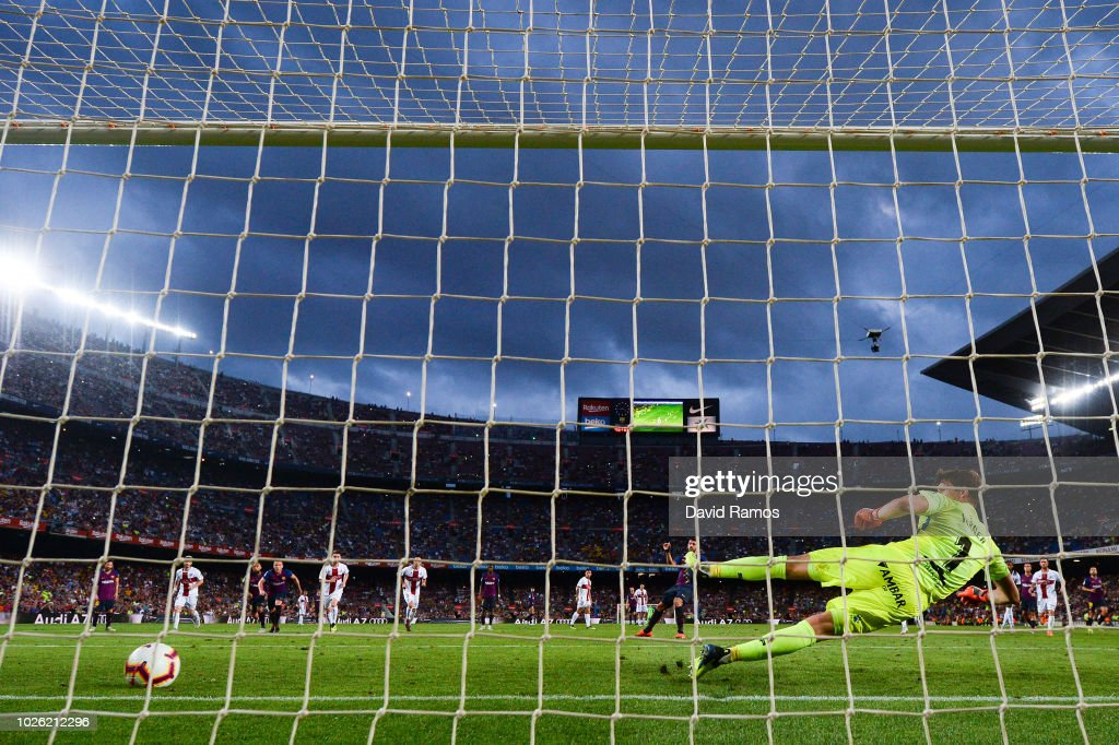 Luis Suarez of FC Barcelona scores his team's eighth goal from the penalty spot during the La Liga match between FC Barcelona and SD Huesca at Camp Nou on September 2, 2018 in Barcelona, Spain.