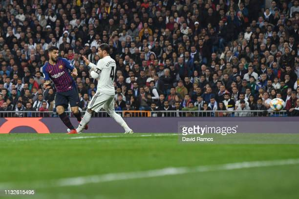 Luis Suarez of FC Barcelona scores his team's first goal past Sergio Ramos of Real Madrid during the Copa del Rey Semi Final second leg match between...