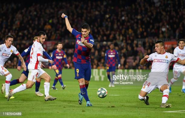 Luis Suarez of FC Barcelona scores his team's fourth goal during the Liga match between FC Barcelona and RCD Mallorca at Camp Nou on December 07 2019...
