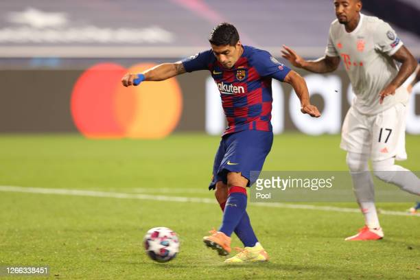 Luis Suarez of FC Barcelona scores his team's second goal during the UEFA Champions League Quarter Final match between Barcelona and Bayern Munich at...