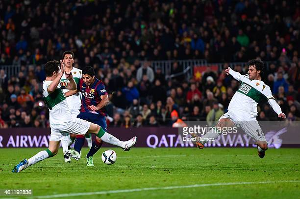 Luis Suarez of FC Barcelona scores his team's second goal during the Copa del Rey Round of 16 First Leg match between FC Barcelona and Elche CF at...