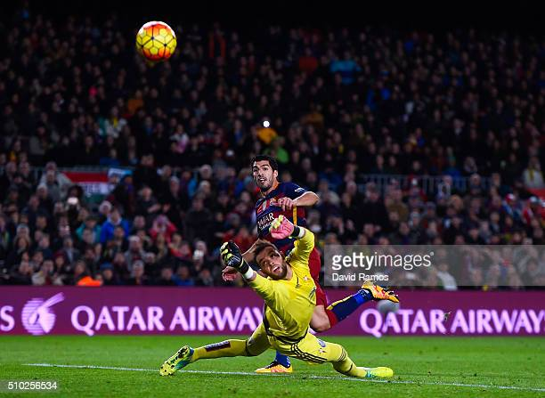 Luis Suarez of FC Barcelona scores his team's second goal past Sergio Alvarez of RC Celta de Vigo during the La Liga match between FC Barcelona and...