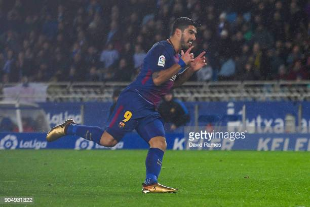 Luis Suarez of FC Barcelona scores his team's third goal during the La Liga match between Real Sociedad and FC Barcelona at Anoeta stadium on January...
