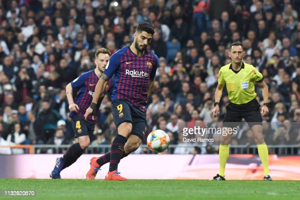 Luis Suarez of FC Barcelona scores his team's third goal from the penalty spot during the Copa del Rey Semi Final second leg match between Real...