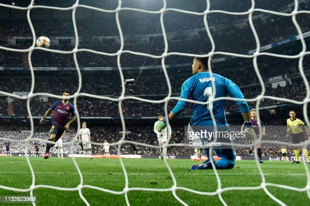 Luis Suarez of FC Barcelona scores his team's third goal with a penalty against goalkeeper Keylor Navas of Real Madrid during the Copa del Rey Semi...