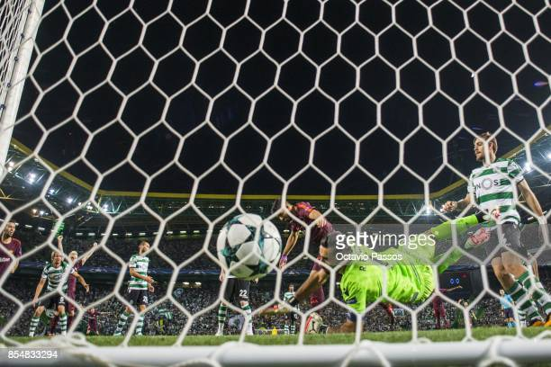 Luis Suarez of FC Barcelona scores the first goal during the UEFA Champions League group D match between Sporting CP and FC Barcelona at Estadio Jose...