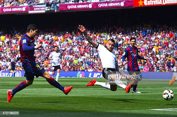Luis Suarez of FC Barcelona scores the opening goal during the La Liga match between FC Barcelona and Valencia CF at Camp Nou on April 18 2015 in...