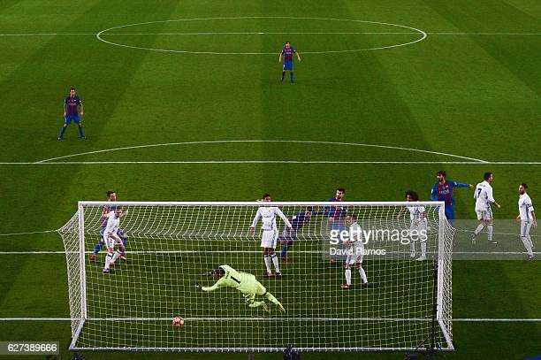 Luis Suarez of FC Barcelona scores the opening goal during the La Liga match between FC Barcelona and Real Madrid CF at Camp Nou stadium on December...
