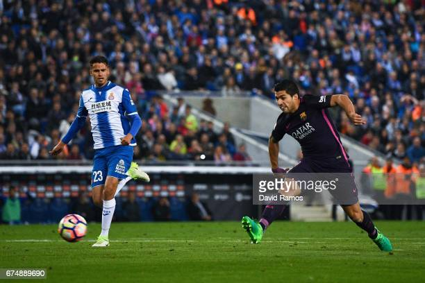Luis Suarez of FC Barcelona scores the opening goal during the La Liga match between RCD Espanyol and FC Barcelona at the RCDE Stadium on April 29...