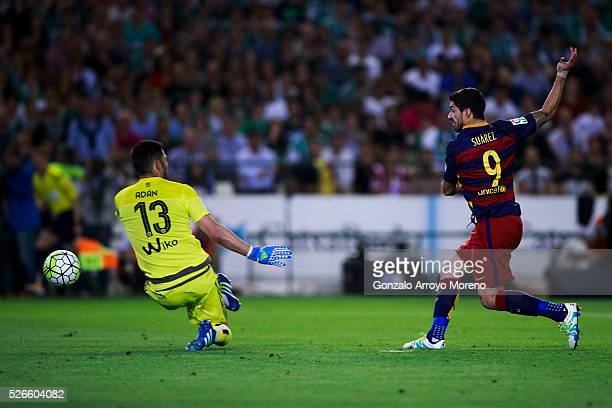 Luis Suarez of FC Barcelona scores their second goal against goalkeeper Antonio Adan of Real Betis Balompie during the La Liga match between Real...