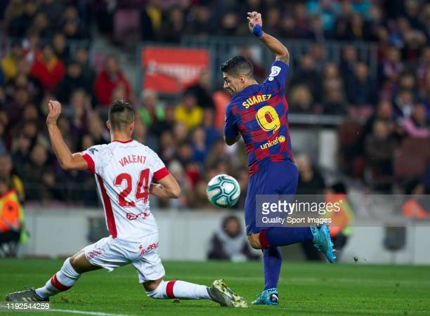 Luis Suarez of FC Barcelona shoots on target during the La Liga match between FC Barcelona and RCD Mallorca at Camp Nou on December 07, 2019 in...