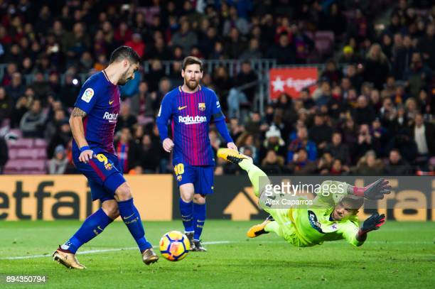 Luis Suarez of FC Barcelona shoots past Ruben Martinez of Deportivo La Coruna and scores the opening goal during the La Liga match between FC...