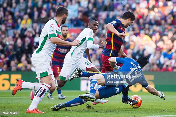 Luis Suarez of FC Barcelona shoots towards goal between David Lomban Uche Henry Agbo and Andres Fernandez of Granada CF during the La Liga match...