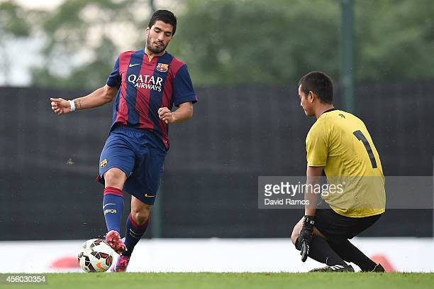 Luis Suarez of FC Barcelona shoots towards goal past Ravi Murdianto of Indonesia U19 match between FC Barcelona B and Indonesia U19 at Ciutat...