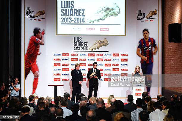Luis Suarez of FC Barcelona stands next to Kenny Dalglish after being awarded the Golden Boot Trophy as the best goal scorer in all European Leagues...